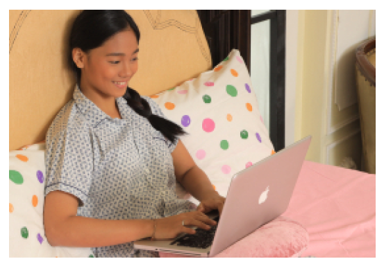 girl-using-laptop-at-home