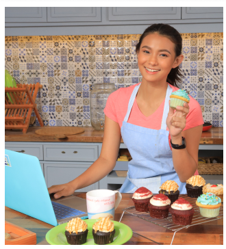 girl-holding-a-cupcake