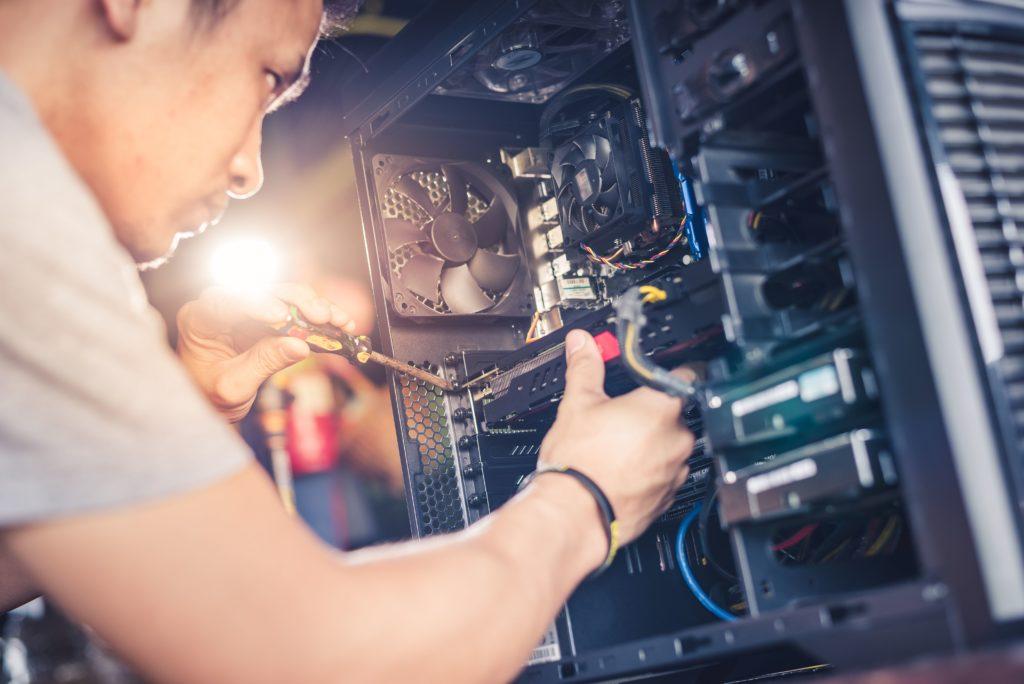 man-fixing-computer