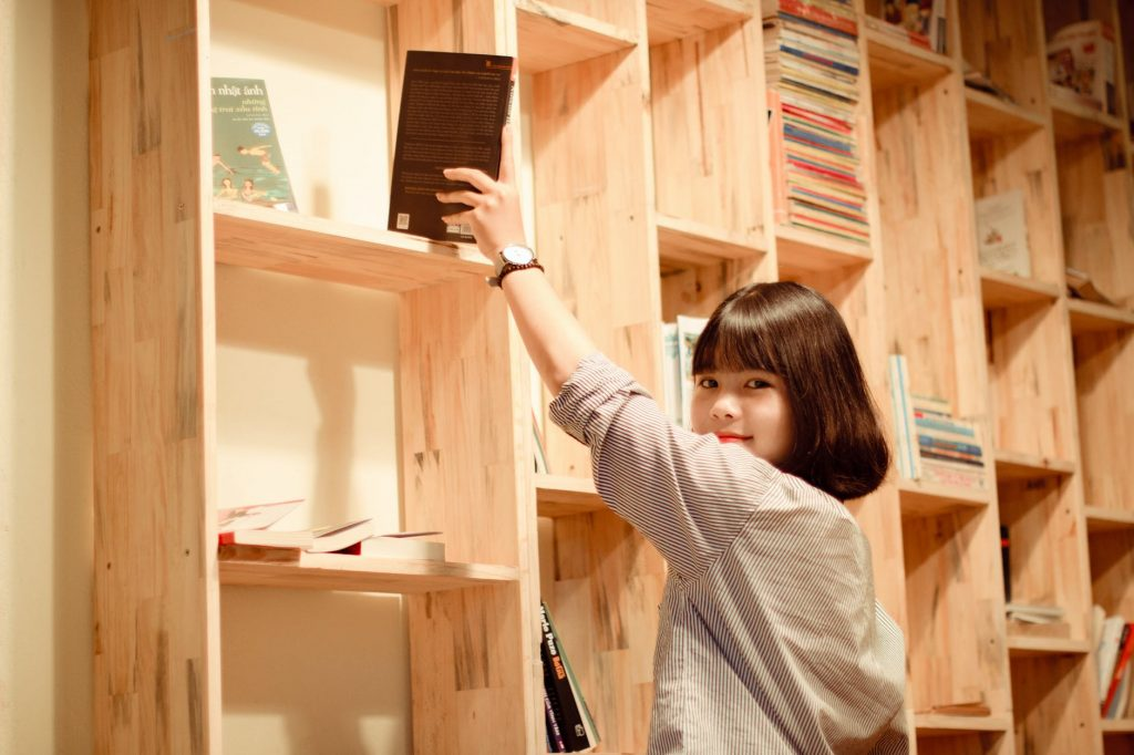 girl getting a book