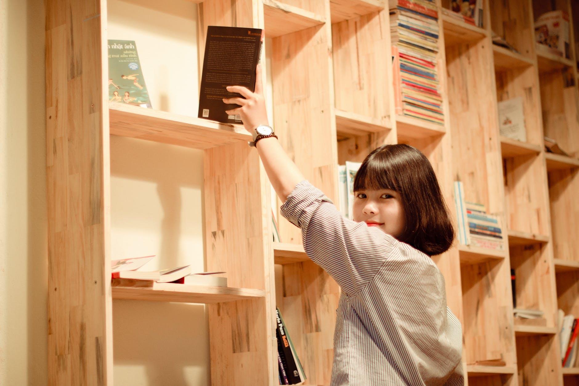 girl getting a book