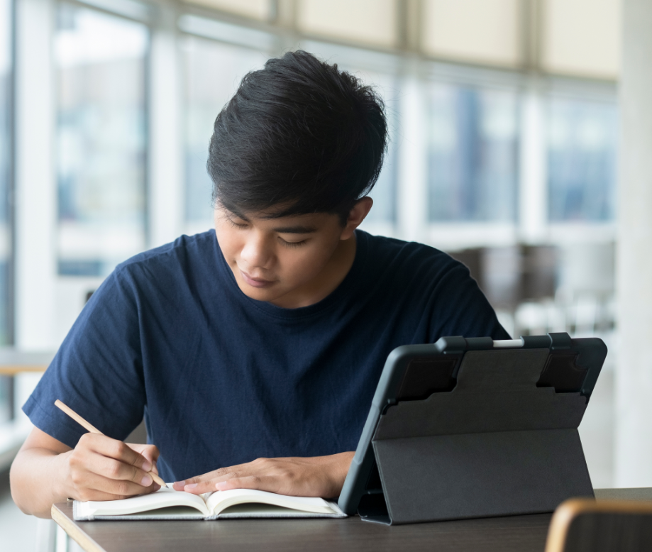 asian student doing homework